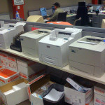 row of printers on an office shelf