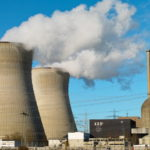 Pictures of cooling towers and steam at nuclear power plant