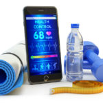 mobile phone app, gym equipment: yoga mat, blue dumbbells, bottle of water and measuring tape isolated on white