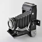 Old rangefinder camera with bellows that lens extends from body